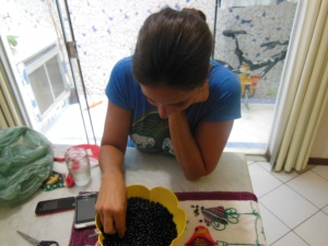 Sarah picking out the ugly beans